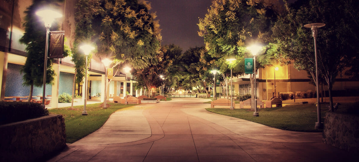 Picture of the Pomona campus lit up by lamp posts.