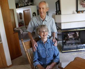 portrait of Joe Clyde, 77, and his wife, Margene Clyde, 75