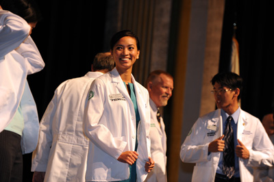 picture of a female student in her white coat