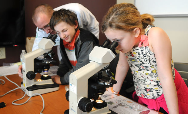 picture of middle-school students using microscopes