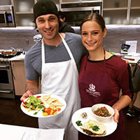 two lifestyle medicine students show dishes which they have prepared