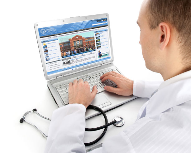 Picture of a white coat medical student viewing the WesternU's website