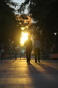 Students walking toward the HEC building at sunset