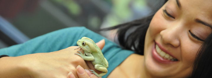 Student with a frog on her hand